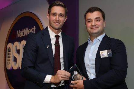 Chris Woakes presents the OSCA Young Volunteer 19-25 award to James Thompson of Berwick Cricket Club, right, during the NatWest OSCAs at Lord's (photo by Steve Bardens/Getty Images for ECB)