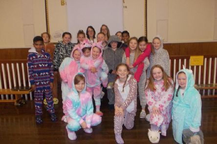 The pupils in their pyjamas ready for their sleepout.