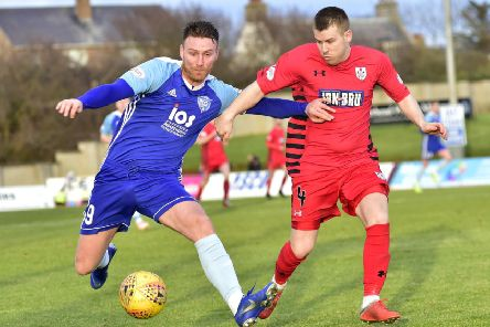 SCOTTISH LEAGUE 2'PETERHEAD V QUEENS PARK'(DUNCAN BROWN)''PETERHEAD'S RORY MCALLISTER HOLDS OFF JAMIE MCKERNON