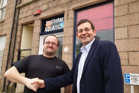 Peterhead businessman and new BID board member Gilbert Burnett (left) - pictured with BID manager and local councillor Iain Sutherland - raised the CCTV petition which attracted more than 800 signatures