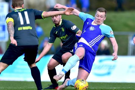 SCOTTISH LEAGUE 2'PETERHEAD VALBION ROVERS'(DUNCAN BROWN)''PETERHEAD'S  SCOTT BROWN IS PULLED DOWN BY GUILIANO MORENA