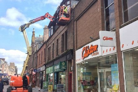 Green-growth and gutter repair work being carried out in the town centre