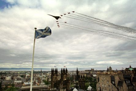 The Red Arrows and Concorde flew over Princes Street Gardens in Edinburgh on July 1, 1999, after the Queen officially opened the Scottish Parliament. This picture was taken by David Moir from the outlook tower and camera obscura at Castlehill.