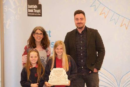 Author Ross MacKenzie presents New Deer School with their First Ministers Reading Challenge award for School Reading the Most Books. Freya and Mia accepted the award along a parent from the school, Angela Verth