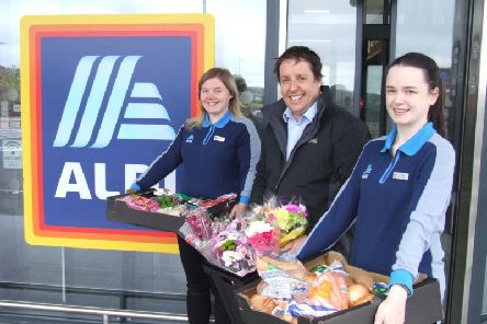 Aldi community champions Heather Carchrie and Talia Cook present the latest donations to Mark Morgan of Stellas Voice