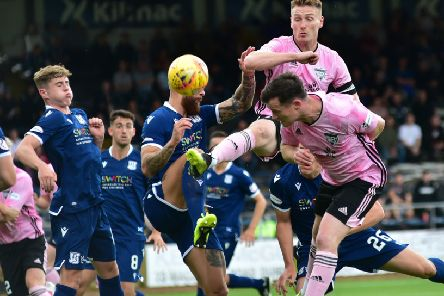 BETFRED LEAGUE CUP'GROUP D'DUNDEE V PETERHEAD'(DUNCAN BROWN)''PETERHEAD'S PADDY BOYLE GETS HIS HEAD IN THE MIDDLE