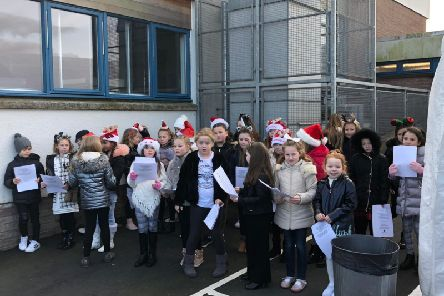 Clerkhill pupils entertain with a song.