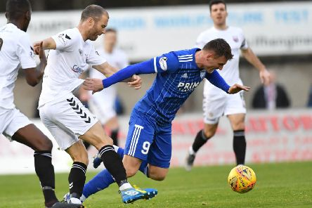 Peterhead's Rory McAllister is brought down by Sean Dillon (pic: Duncan Brown)