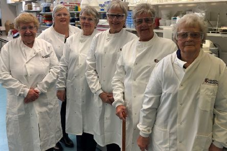 Wilma Bruce with her friends and fellow fundraisers on the tour of the laboratories