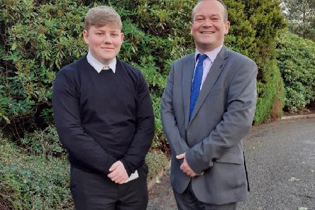 Ethan Thomson pictured alongside Laurence Findlay during a work experience placement at Woodhill House.