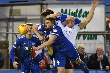Peterhead's Cameron Eadie clears from Conor Sammon (pic: Duncan Brown)