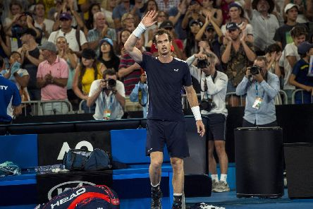 Andy Murray waves goodbye to fans after his defeat in the first round of the Australian Open on Monday (Pic by Bill Murray)
