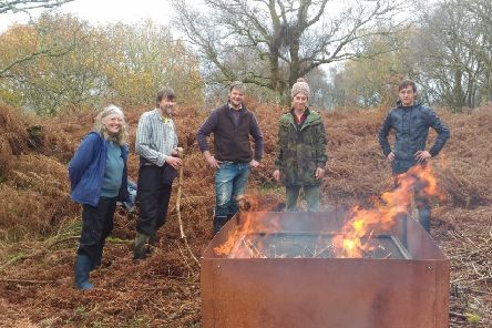 A group making biochar from waste left over from rhododendron removal. Ed Tyler (2nd from left) is a member of the Green Network Project team and he and his wife Carina Spink (on the far left) are Directors of Local Bioregioning CIC.