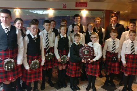 The Isle of Bute Schools Pipe band were crowned champions in the debut category at the Scottish Schools Pipe Band Championship.