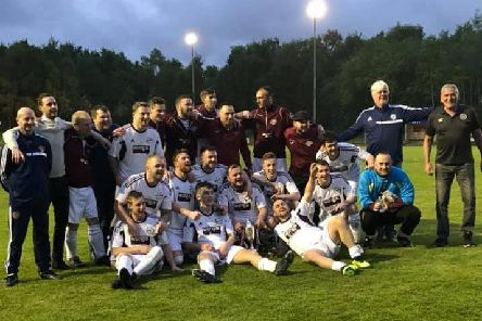 Carluke Hearts players and backroom staff celebrate with cup (Pic courtesy of Carluke Hearts)