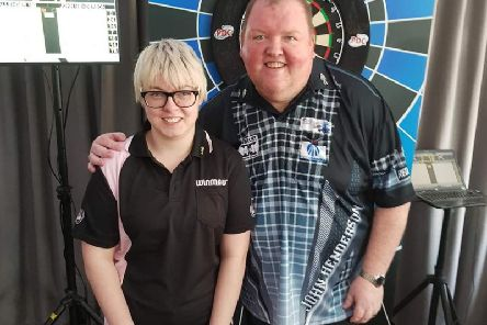 Jenna Kelman pictured with professional darts ace John Henderson