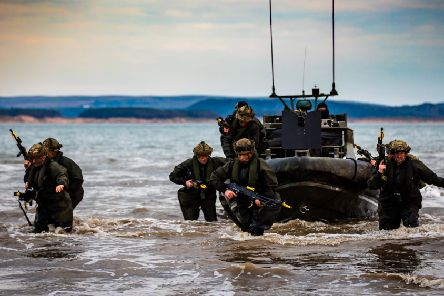 Members of Alpha Company, 40 Commando Royal Marines during their amphibious insertion by Offshore Raiding Craft (ORC)during Exercise Joint Warrior. last year.