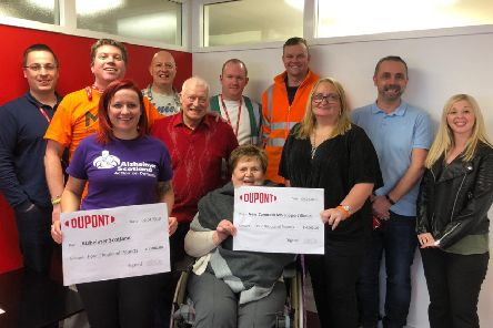 DuPont Girvan presented cheques of �4000 each to MS Support and Alzheimer's Scotland.