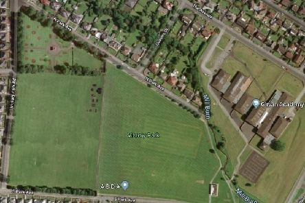 The 3G pitch will be situated on the green space  to the left of the existing  playground
