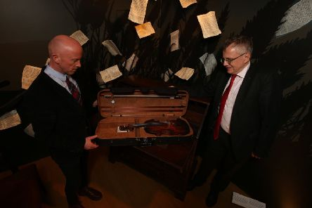 The violin is pictured here ahead of its departure with Murray Pittock, National Trust for Scotland Trustee and David Hopes, the National Trust for Scotland's head of collections and interiors