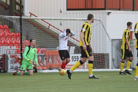 David Goodwilllie heads in his hands (picture: Craig Black) Clyde 1 Dumbarton 2