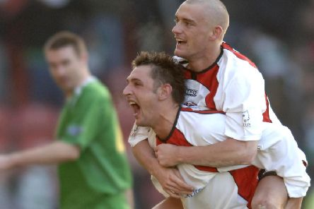 Clyde players Alex Williams and Tom Brighton celebrate after their famous cup win over Celtic in  2006