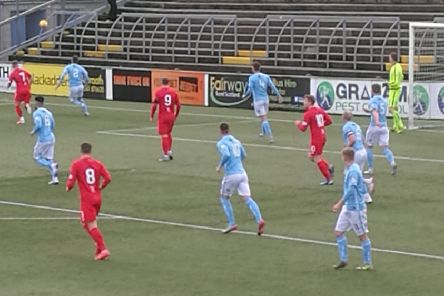 Clyde, in red, try to make an early impression in the Forfar penalty area.