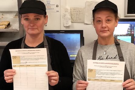 Lynn Rennie and Ashley Swift of Rennies Bakery in Kilsyth holding petitions against car parking charges