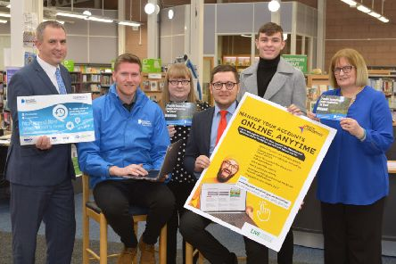 Launching North Lanarkshire Council's online portal are (l-r) Stephen Chambers (Digital Scotland), Ian Chapman (Openreach), Elaine Ford (library supervisor), Councillor Kenneth Duffy, Mackenzie McDougall (modern apprentice) and Mary McGunnigael (library assistant)