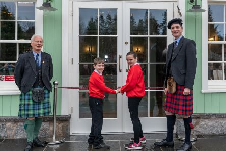 L_R: Games President David Geddes, Lewis Mutch and Diamond MacKay of Braemar School with the  Duke of Fife.