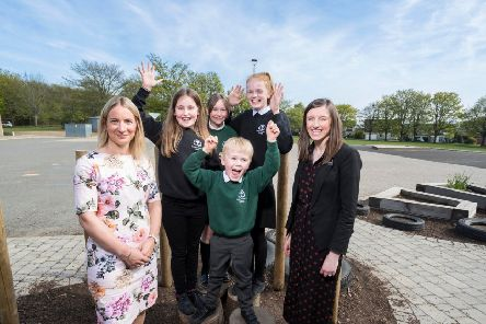 Morven McKay, left, acting head teacher, and Emma Gelati, marketing manager at CALA Homes North, with Cults pupils