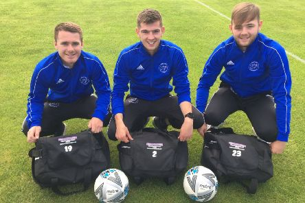 Allan and Black Coach Hire, Aboyne sponsor Banchory FC  players kit bags until 2021. Pictured are Left, Greg Smith, Darren Reid and on the right is Euan Rose.