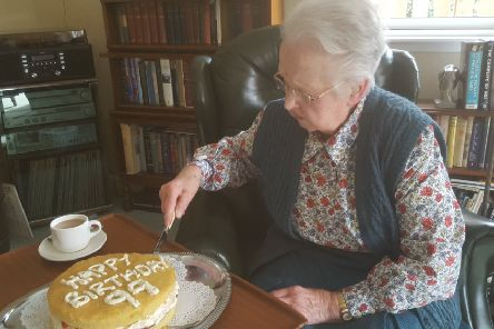 Jean cutting her 99th birthday cake