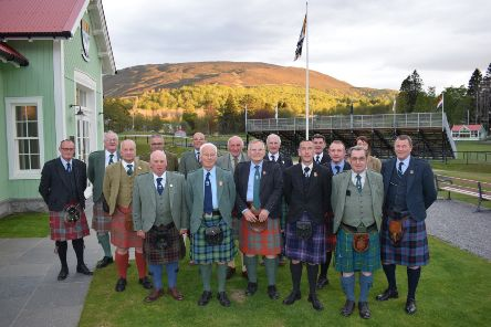 Outside their new offices, Braemar Royal Highland Society committee members with president David Geddes, front, second  left