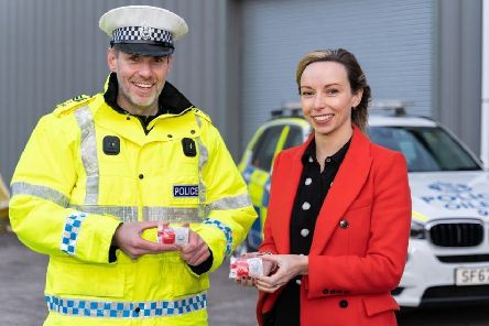 Sergeant Dominic Doyle and Jodi Gordon, partner at Cycle Law Scotland, launch the #LightUp campaign.