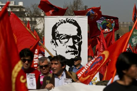 Demonstrators carry a banner of Chile's late President Salvador Allende, days ahead of the 45th anniversary of the 1973 military coup that toppled him (Picture: Esteban Felix/AP)
