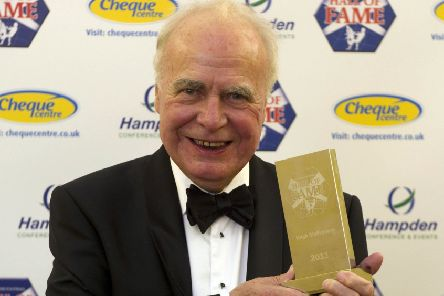 Hugh McIlvanney celebrates after being inducted into the Scottish Football Hall of Fame in 2011. Picture: SNS