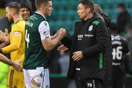 Paul Heckingbottom speaks with Paul Hanlon after Hibs recorded a 2-0 win over Hamilton