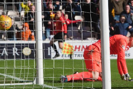 Colin Doyle concedes a stoppage time goal to cost Hearts a result at Fir Park.
