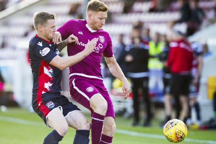 Jason 'Thomson, in 'Arbroath's colours, battles with Michael Gardyne of Ross County