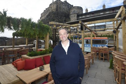 Owner Nic Wood on the iconic roof terrace of the new Cold Town House.''Pic - Greg Macvean.