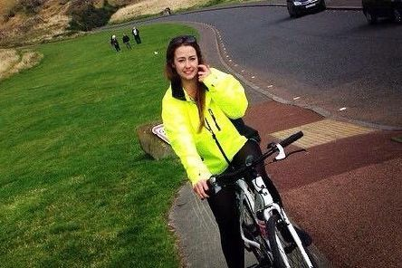 Olivia Pullman with her beloved 'Bichael' near Arthur's Seat. Picture: Contributed