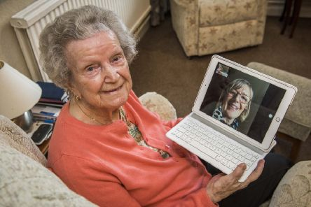 Nan keeps in touch with daughter Dorothy over the internet. Picture: Chris Watt