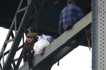 Four climate change protesters from Extinction Rebellion climbing the Finnieston Crane, Glasgow.