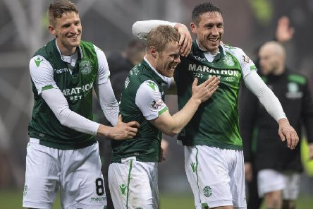 Vykintas Slivka, left, and Mark Milligan, right, celebrate at full time after defeating Hearts in the derby with two-goal Daryl Horgan