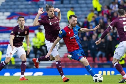 Peter Haring (centre left) is a doubt for the match against Rangers. Picture: SNS