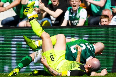 Hibs captain David Gray sends his opposite number, Celtic's Scott Brown, tumbling
