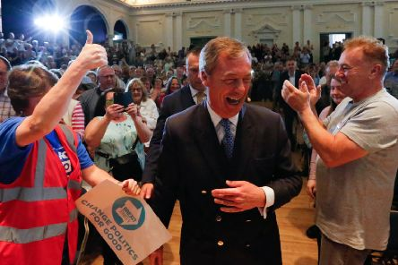 Nigel Farage us cheered by supporters at a Brexit party rally in Nottingham. Picture: SWNS