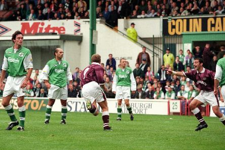 John Robertson wheels away after netting against Hibs at Easter Road