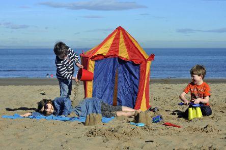 Children play on Portobello Beach as Scotland enjoys its hottest day of the year. Picture: Phil Wilkinson